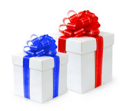 Fancy Holiday Gift Box. Es with red and blue bows Isolated on white background Stock Photos