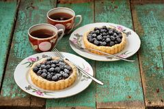 Fancy homemade cakes with fresh blackberries and chocolate cream Stock Photo