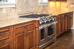 Fancy kitchen with large oven and stove Royalty Free Stock Images