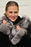 Fancy lady wearing a fur coat Stock Photography