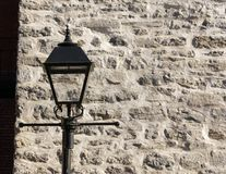 Fancy  lantern and stone wall stock image