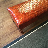 Fancy leather bench on wooden floor Royalty Free Stock Images