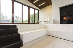 Fancy living room with stairs Stock Photo