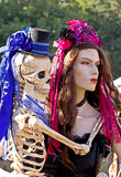 Fancy Mannequin Holding Skeleton Royalty Free Stock Photo