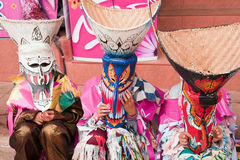 Fancy masks. Children with a fancy mask, the mask festival in Thailand known as Phi Ta Khon Festival. This is a festival of the people walking on the street Stock Photo