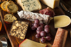 Fancy Meat and Cheeseboard with Fruit Royalty Free Stock Photography