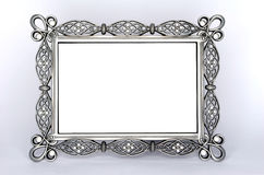 A Fancy Metal Photo Frame. A metal photo frame with some diamond-like pieces. On white background with a soft large shadow around it Royalty Free Stock Photos