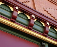 Fancy Molding. Fancy intricately patterned wooden building molding painted colorfully in red yellow and green Royalty Free Stock Photos