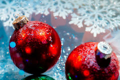 Fancy new year frozen balls with ice water drops bokeh Stock Images