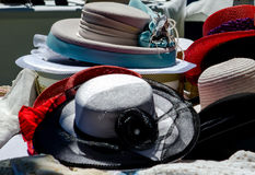 Fancy old hats at a outdoor market stock photo