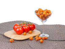 Fancy orange cherry tomatoes and red tomatoes on vine. Royalty Free Stock Image