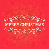 Fancy ornate borders with text merry christmas at red textured background Royalty Free Stock Image