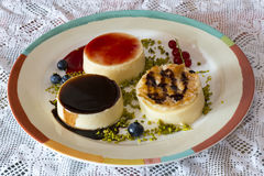 Fancy panna cotta with blueberries and green  little pistachio. In homemade table Royalty Free Stock Photography