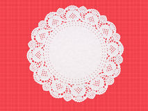 Fancy paper doily, round, perforated and embossed Royalty Free Stock Photos