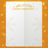 Fancy paper frame with ornate elements and text merry christmas at orange background with glowing lights and bokeh Stock Photo