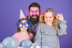 Fancy party. Family of father and daughters wearing party goggles. Family party. Happy family celebrating birthday party. Father and girl children enjoying stock photography