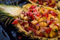 Fancy Pineapple Salsa. Fancy sweet whole pineapple half salsa South American appetizer royalty free stock photos