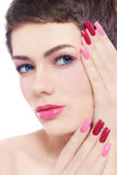 Fancy pink manicure. Close-up portrait of young beautiful woman with fancy pink manicure Royalty Free Stock Photo