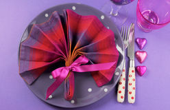 Fancy pink and purple table setting with fan shape napkin - aerial Royalty Free Stock Photos