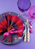 Fancy pink and purple table setting with fan shape napkin - vertical. Fancy pink and purple table setting with fan shape napkin setting and polka dot plate and Stock Image