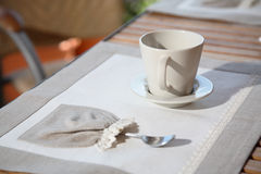 Fancy place mat and coffee cup stock photography