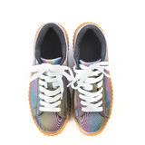 Fancy platform sneakers. Fashionable platform sneakers with a holographic rainbow design Stock Photos