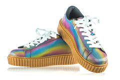 Fancy platform sneakers. Fashionable platform sneakers with a holographic rainbow design Royalty Free Stock Images