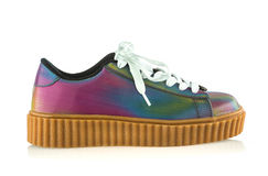 Fancy platform sneakers. Fashionable platform sneakers with a holographic rainbow design Royalty Free Stock Photography