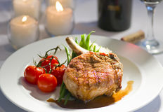 Fancy Pork Chop And Candles Royalty Free Stock Image