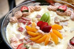 Fancy pudding. Fancy decorated pudding with cream and sliced fruits Royalty Free Stock Photos
