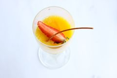 Fancy pudding. Fancy yellow pudding with garnish in glass cup Stock Photography