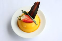 Fancy pudding. Yellow pudding fancy decorated with strawberry garnish Royalty Free Stock Image