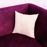 Fancy purple sofa with white cushion Stock Photo