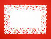 Fancy Real White Doily. Isolated on red background Royalty Free Stock Photography