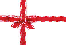 Fancy red ribbon gift bow with white stitching. Isolated on white background Royalty Free Stock Photos