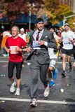 Fancy runner. Young man dressed in a fancy suit runs the 2013 NYC Marathon on November 3, 2013 in New York Stock Photos