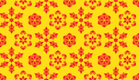 Fancy seamless pattern of red and orange geometrical elements on yellow background Royalty Free Stock Photography