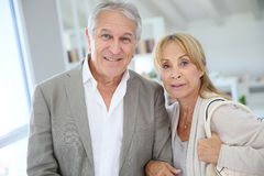Fancy senior couple standing at home Stock Photo