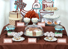 Fancy set table with sweets candies, cake, marshmallows, zephyr,. Homemade fancy set table with sweets candies, cake, marshmallows, zephyr, nuts, almonds Royalty Free Stock Images