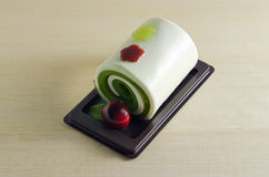 Fancy soap in rolled cake form with cherry Royalty Free Stock Photography