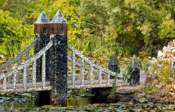 Fancy Stone Bridge in Lush Garden Royalty Free Stock Photos