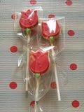 Fancy sugar cookies. In plastic bag. Three red tulip flowers Stock Images
