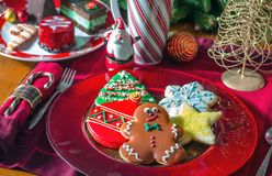 Fancy sugar cookies on a holiday sweet table. Decorated sugar cookies, fancy pastries and Christmas decorations Stock Photos