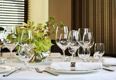 Fancy table set for a dinner. With flower bouqet Royalty Free Stock Image