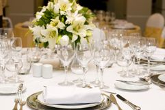 Fancy table set for a wedding celebration. And flowers Stock Image