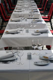 Fancy Tables Set for Dinner. Fancy tables set for a formal dinner Royalty Free Stock Images