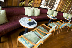 Fancy Tavern or Bar in a Luxury Resort Hotel. Chairs and tables and lounge furniture in a fancy tavern or bar. The venue is in a luxury resort hotel Royalty Free Stock Photography