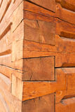 Fancy timber joints on the corner of log cabin Royalty Free Stock Photography