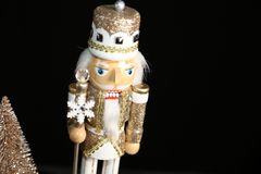 Fancy toy soldier standing on guard- mall billboards. Christmas toy soldier dressed in gold glitter on display with gold tree. This ad is designed for Christmas royalty free stock photography