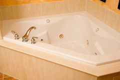 Fancy tub. A nice jetted tub in luxury home bathroom Stock Photos